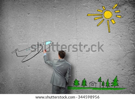Rear view of businessman drawing tarvel sketch - stock photo