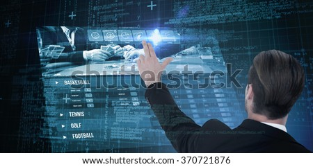 Rear view of businessman pointing with his fingers against blue matrix and codes - stock photo