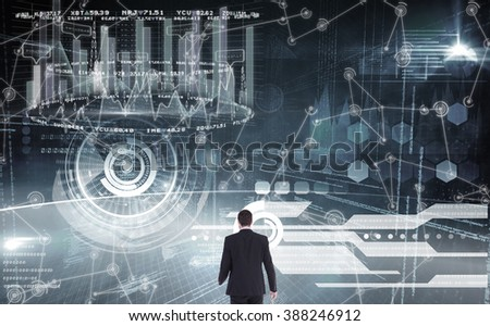 Rear view of businessman standing against hologram background - stock photo