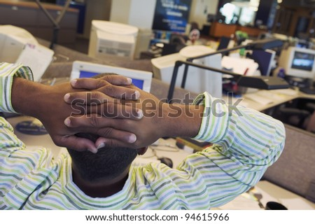 Rear view of businessman with hands on head - stock photo