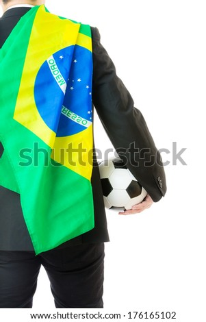 Rear view of businessman with soccerball and brazil flag