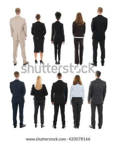 Rear View Of Businesspeople Standing In Row Against White Background