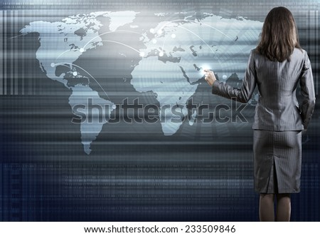 Rear view of businesswoman pointing on media screen