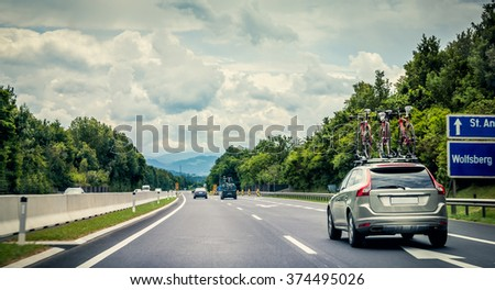 Rear view of cars driving an austrian motorway - stock photo