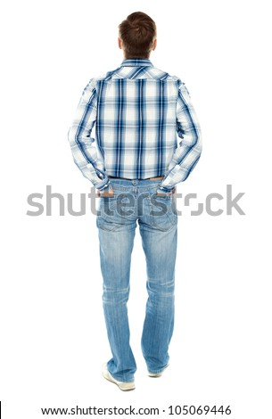 Rear view of casual male looking upwards. Posing with hands in back pocket