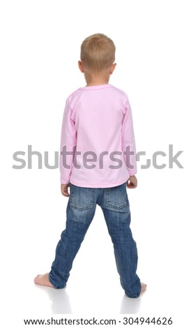 Rear view of caucasian full body american baby boy kid in pink sweater and jeans standing isolated on a white background - stock photo