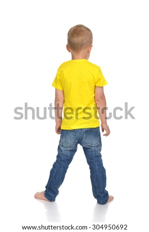 Rear view of caucasian full body american baby boy kid in yellow tshirt and jeans standing isolated on a white background - stock photo