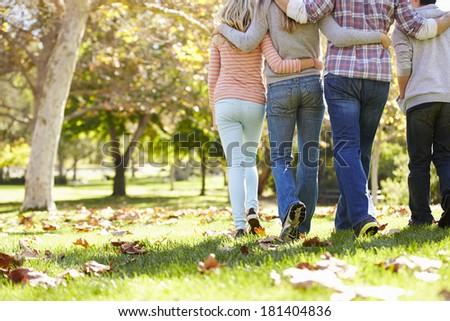 Rear View Of Family Walking Through Autumn Woodland - stock photo