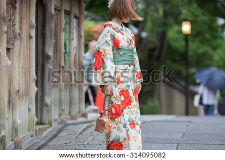 Rear view of Geisha in Kyoto - stock photo