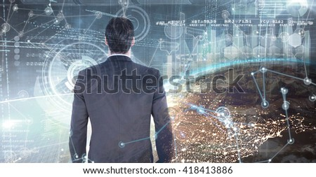 Rear view of handsome businessman against image of a earth - stock photo