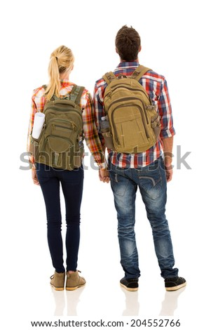 rear view of hiking couple holding hands isolated on white background - stock photo
