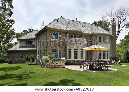 Rear view of luxury brick home with patio - stock photo