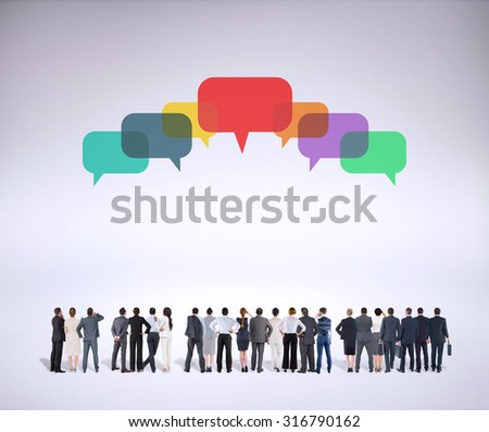 Rear view of multiethnic business people standing side by side against grey background - stock photo