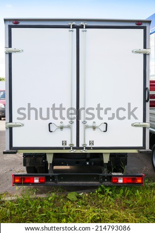 Rear view of new white cargo truck - stock photo