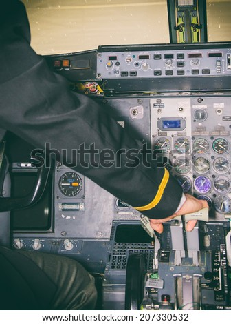 Rear view of pilot in aircraft cabin. - stock photo