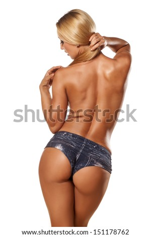 Rear view of pretty and muscular topless girl with blond hair - stock photo