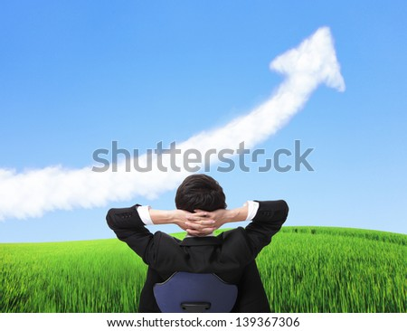 Rear view of relax business man sit on chair and watch growth arrow cloud, business concept, asian people