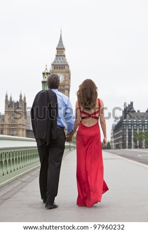 Rear view of romantic man and woman couple on Westminster Bridge with Big Ben in the background, London, England, Great Britain - stock photo