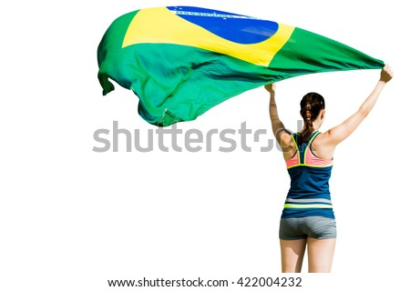 Rear view of sportswoman raising a brazilian flag