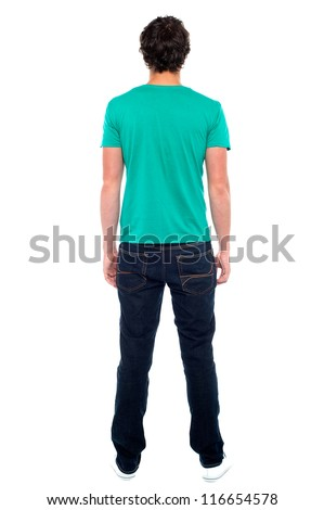 Rear view of teen guy in casuals. Full length portrait