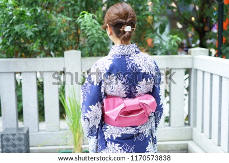 https://thumb9.shutterstock.com/display_pic_with_logo/167494286/1170573838/stock-photo-rear-view-of-wearing-yukata-1170573838.jpg