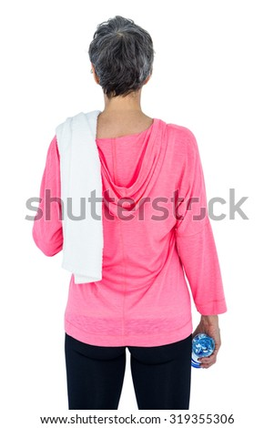Rear view of woman with towel on shoulder holding bottle against white background