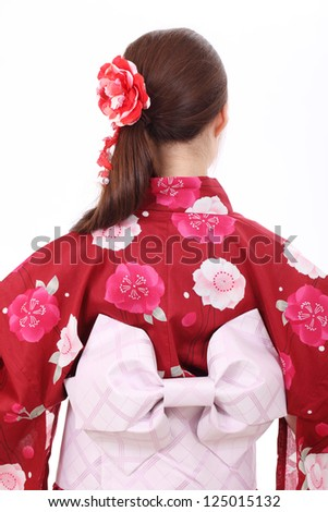 Rear view of young asian woman with traditional clothing kimono - stock photo