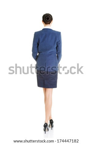 Rear view of young beautiful businesswoman, isolated on white - stock photo
