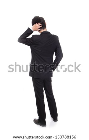 Rear view of young business man confused, isolated over white background, full length portrait of asian businessman standing back