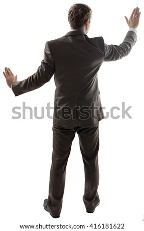 Rear view of young business man pointing at copy space isolated over white background, full length portrait of businessman standing back - stock photo