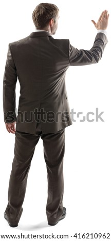 Rear view of young business man touching at copy space isolated over white background. Full length portrait of businessman standing back