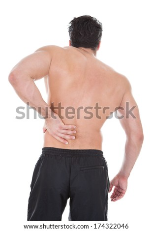 Rear View Of Young Man Suffering From Back Pain