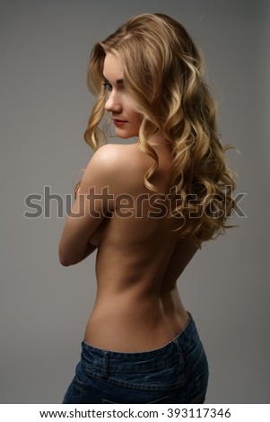 Rear view on topless fair-haired model posing