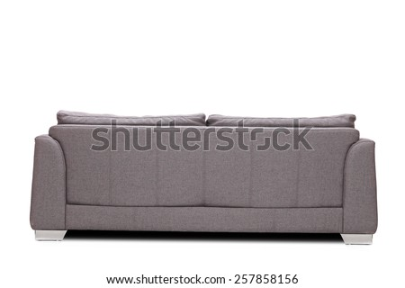 Rear view studio shot of a modern gray sofa isolated on white background - stock photo