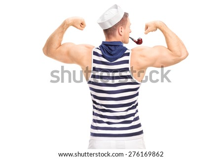 Rear view, studio shot of a muscular man in sailor outfit with smoking a pipe and flexing his biceps isolated on white background - stock photo