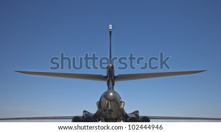 Rear view tail details of a B-1 bomber, with text space. - stock photo