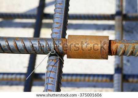 Rebar connection point in the construction site - stock photo