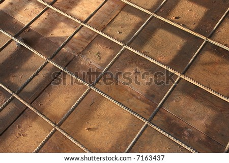 rebar gridwork across a floor for strength - stock photo