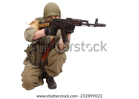 rebel with AK 47 isolated on white background - stock photo