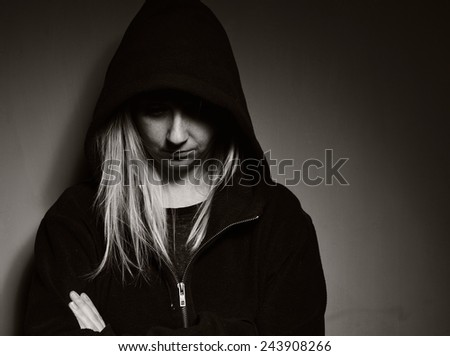Rebellious teenager in a hoodie. MANY OTHER PHOTOS FROM THIS SERIES IN MY PORTFOLIO. - stock photo