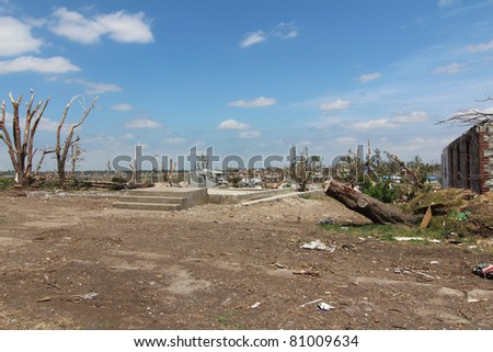 Rebuilding begins after a devastating EF-5 tornado by first clearing the grounds and home foundations of debris. - stock photo