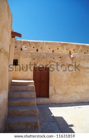 Rebuilt historic Fort Zubarah (Al Zubara) in North East of the deserts of Qatar on the edge of the Persian gulf on a sunny summer day