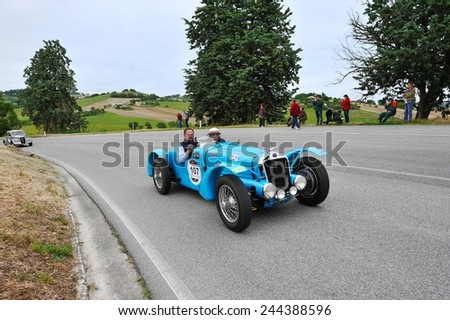 RECANATI (MC), ITALY - MAY 16: A blue Delage D6 75 sport  takes part to the 1000 Miglia classic car race on May 16, 2014 near Recanati (MC). The car was built in 1936 - stock photo