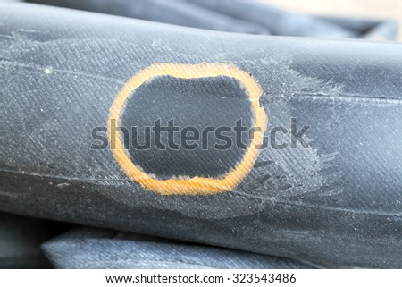 Recapped inner tube for bicycle with orange patch when pump up and ready to use - stock photo
