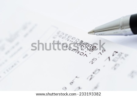 Receipt from shop and a ball pen closeup image - stock photo
