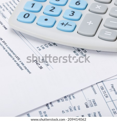 Receipt next to calculator - 1 to 1 ratio - stock photo