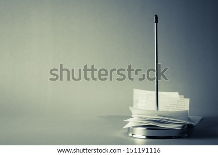 Receipts in paper nail - stock photo