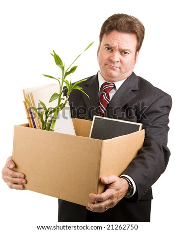 Recently fired businessman holding a cardboard box filled with his belongings.  Isolated on white.