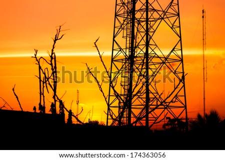 reception antenna with orange sky - stock photo