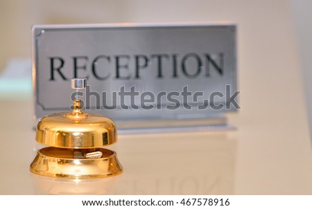 Reception bell and card sign on desk